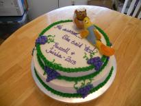 Engagement Cake - The figures apparently are an inside joke regarding their pet names for one another. He asked her to marry him at a winery so therefore the clusters of grapes.
