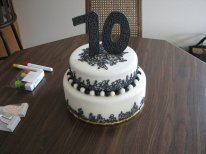 Tiered 70th Birthday Cake - Royal icing piping and fondant balls with a 70 made from fondant as well.