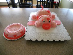 Puppy Dog Cake with Water Dish smash cake - For my niece's first birthday. The puppy dog was made with two round glass bowls (Pampered Chef large and small). I didn't want to cover it in fondant so went old school with the piping stars.