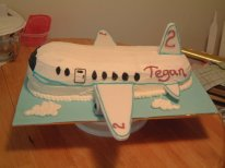 Airplane Cake - my nephew's second birthday. This one was a pain. It just wouldn't carve properly, the cake was just falling apart. The wings are actually made from thick pieces of display board and covered in fondant, so non-edible.