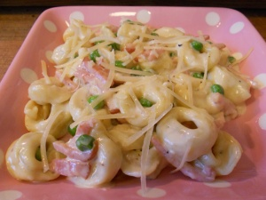 Tortellini with peas and ham in alfredo sauce