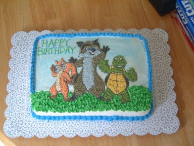 Over the Hedge Cake - just a sheet cake with the little stars. I pretty much free hand these images and then pipe the stars to get dimension and details.