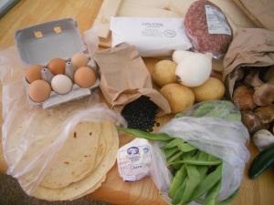 1/2 dozen eggs, black beans, fresh linguine, ground beef, onion, garlic, potatoes, green beans, chevre, fresh flour tortillas