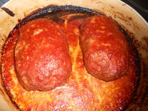 baked mini meatloaves with tomato sauce topping
