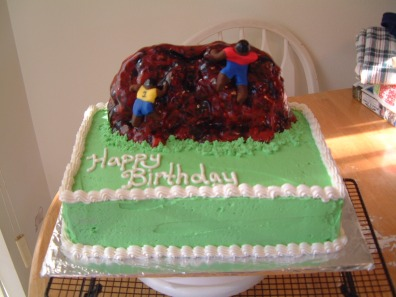 Rock Wall Climbing cake - my first non-flat cake, sort of. The rock wall is rice krispies with fondant covering it. My first attempt at painting fondant. Don't ask, you don't want to know.
