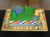Lego Cake - The little legos are fondant with Royal icing dots for the little pegs. The car and the house are rice krispies. Took forever to make the little lego pieces.