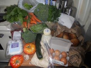 Spinach, carrots, mixed greens, broccoli, fresh spaghetti pasta, fresh rolls, dried garbanzo beans, eggs, fresh pizza dough, zucchini, fresh cream, heirloom tomatoes, garlic, frommage blanc, beef stir fry