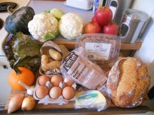 Buttercup squash, cauliflower, cabbage, apples, whole wheat fusilli pasta, Potato bread, cheddar cheese, fresh bratwurst, fingerling potatoes, eggs, lettuce, decorative pumpkin, garlic, onions