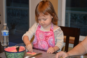 My niece carefully sprinkling her cookie.