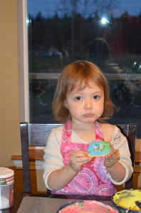 My niece enjoying her beautifully decorated cookie.
