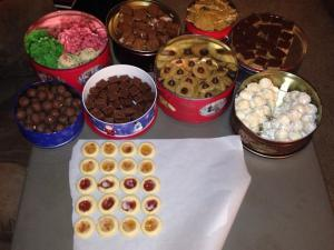 This is day 1 of baking - here we have from the top left: Spritz cookies, Chocolate Caramel Bars, Peanut Brittle, Scotchy Peanut Butter Bars. Bottom left: Peanut Butter Balls, Chocolate Fudge, Peanut Butter Blossoms, Mexican Wedding Cakes (with and without nuts), Raspberry Thumbprints (with strawberry and apricot)