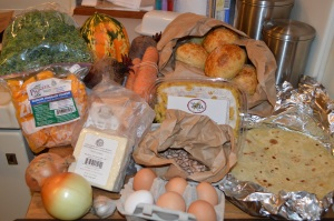 Kale, carnival squash, carrots, beets, Rosemary rolls, fresh flour tortillas, fusilli pasta, pinto beans, egggs, garlic, onion, Jack cheese, bulk Italian sausage, hubbard squash