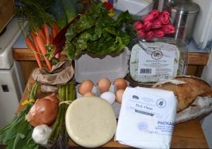 carrots, rhubarb, swiss chard, tulips, fresh spinach fettucine, potato bread, pork chops, eggs, pie crust dough, asparagus, garlic, onion, shallot, sage, white beans