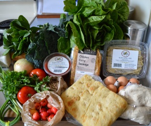 Spinach, kale, romaine lettuce, fresh olive fettuccine, eggs, fresh pizza dough, focaccia, chicken curry sausage, marinara sauce, garbanzo beans, a bonus - fresh Rainier cherries, tomatoes, parsley, garlic scapes, green garlic, onion