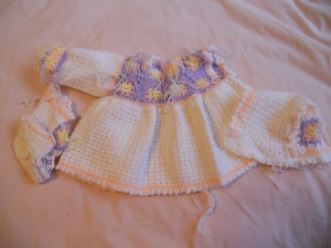 Another 20+ years in the making. A granny square baby dress. Still have one sleeve to do and weaving in ends.