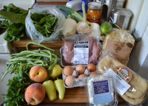 Lettuce, basil, Walla Walla onions, fresh garlic, peaches, cucumber, fresh radiatore pasta, flat breads, fromage blanc, eggs, pork kabob, green beans, banana peppers, peaches, cilantro