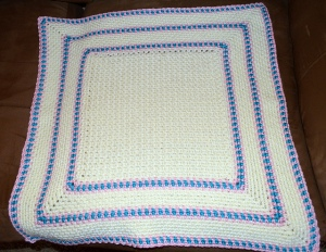 The first Picture Perfect afghan. I only had to do a portion of it for a test. I used what yarn I had immediately on hand and wasn't really too pleased with the color combination. I will finish it up and hang on to it until someone else needs a baby blanket.