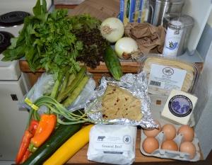 spinach, cilantro, lettuce, cucumber, Walla Walla onions, pinto beans, berry tea, fresh buccatini, Jack cheese, eggs, ground beef, fresh flour tortillas, zucchini, peppers, garlic scapes, fava beans
