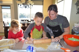 My niece, nephew and daughter rolling out cookie dough.