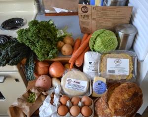 Two types of kale, potatoes, carrots, cabbage, gemelli pasta, ground beef, onion, garlic, split peas, almonds, pie crust dough, eggs, gouda cheese and fresh potato bread
